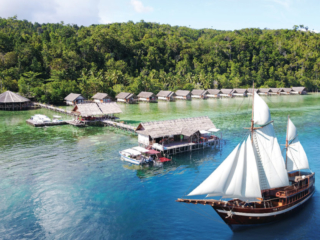our Coralia Liveaboard in front of our resort Papua Explorers in Raja Ampat