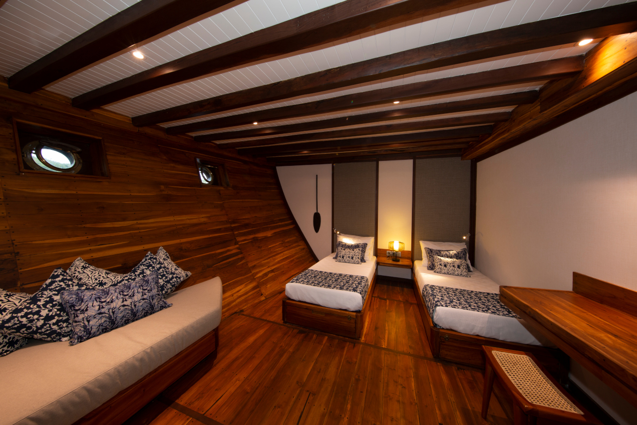 cabin with two seperate beds on our Coralia Liveaboard in Indonesia
