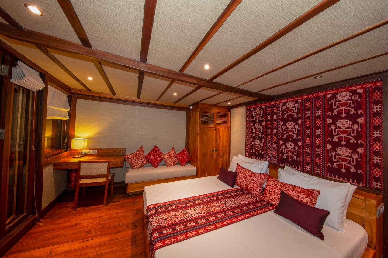 our ocean view cabin on Coralia Liveaboard Indoensia at night