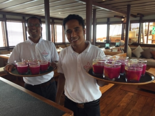 members of our friendly service team serving drinks on Coralia Liveaboard Indonesia