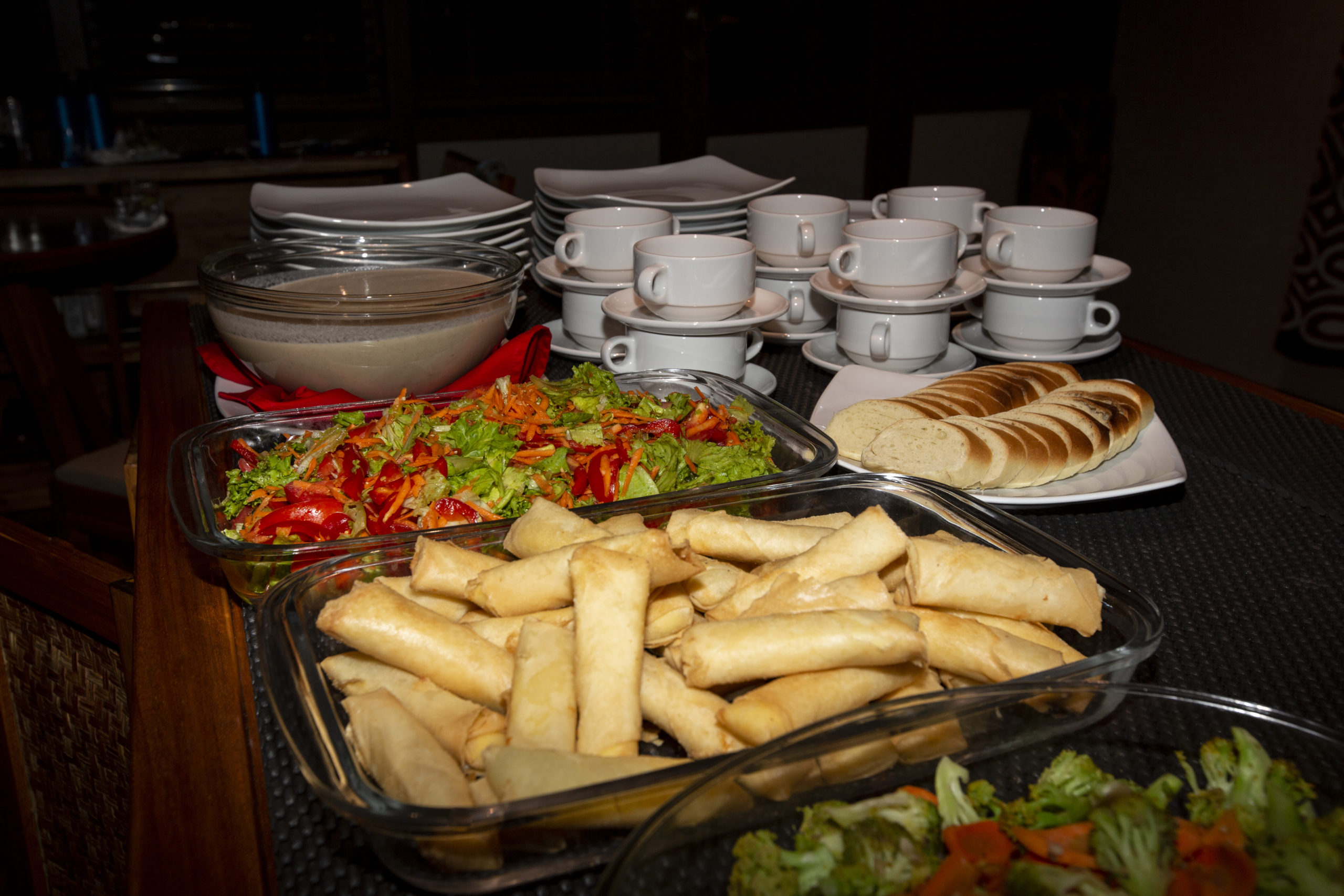 plates of Indonesian spring rolls and salads on Coralia Liveaboards buffet