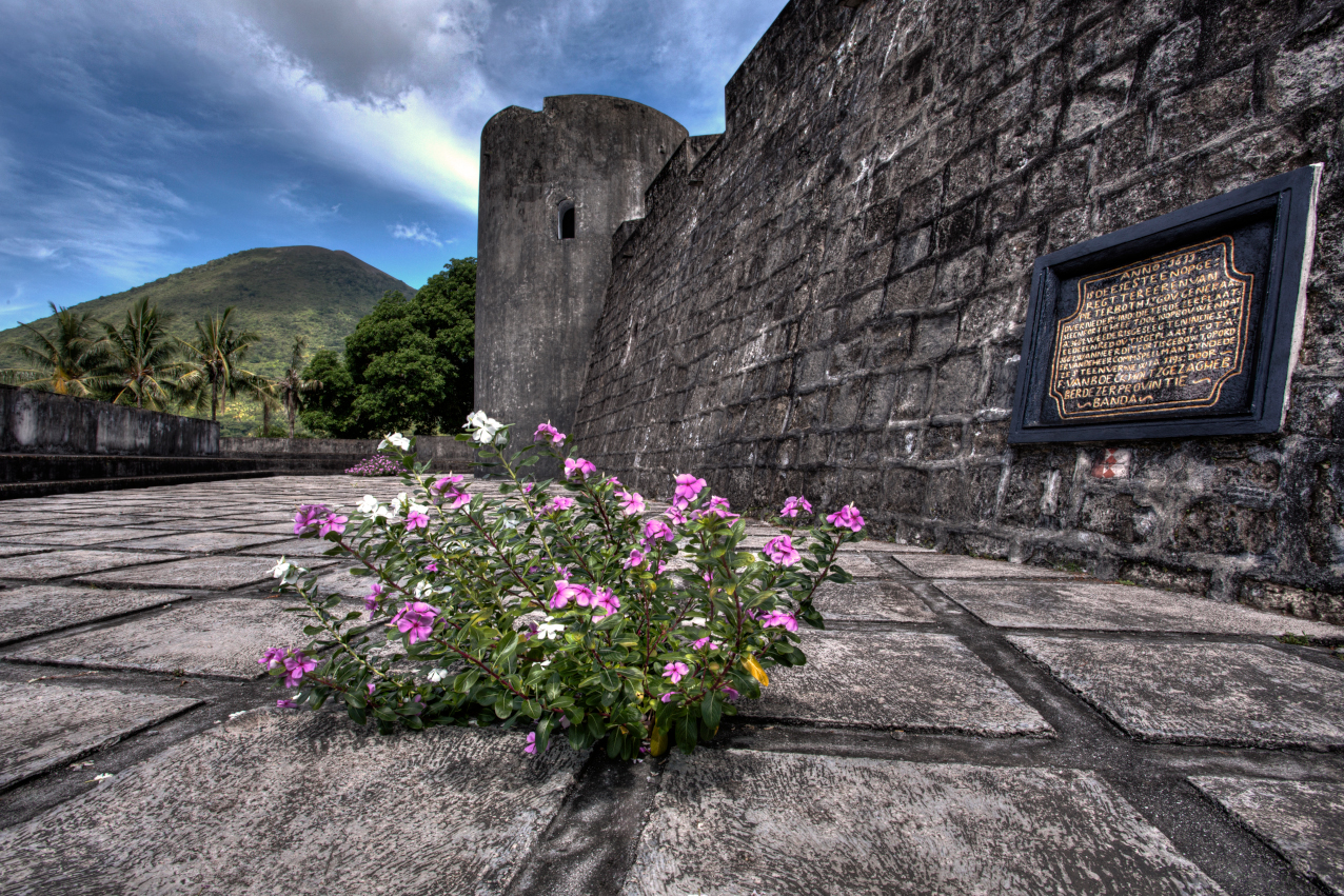 Dutch fort on Banda Neira in the Banda Islands with the volcano in the background with Coralia Liveaboard in Indonesia