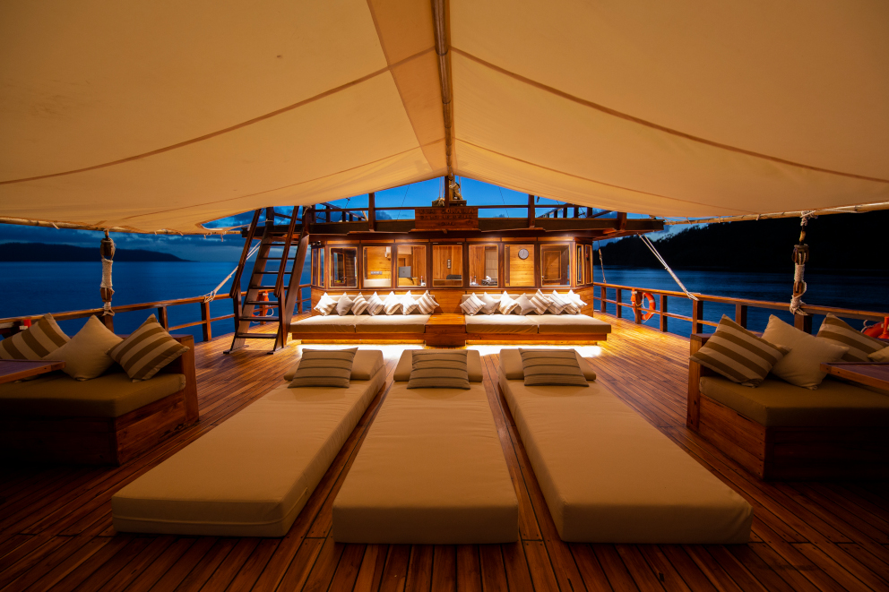 Sunbeds and seating areas on our spacious upper deck aboard Coralia Liveaboard in Indonesia